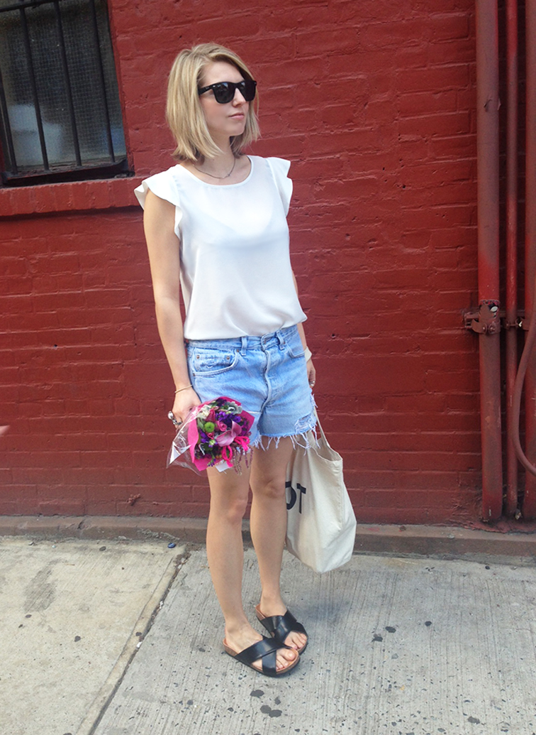 H&M black slide sandals, Birkenstocks, distressed denim shorts, vintage Levi's, pink flowers springtime bouquet