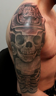 aztec tattoo covering the shoulder and the upper arm