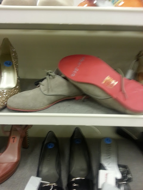 A picture of shoes on display at T. J. Maxx