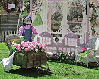 Easter garden with hay wheelbarrow and bunny
