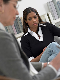 a young woman involved in a counseling session.