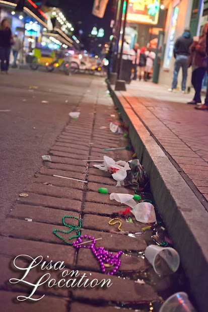 Discarded beads and litter filled the gutters of Bourbon Street in the French Quarter
