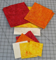 Island Batik batiks used in Leah Day's Machine Quilting Block Party block