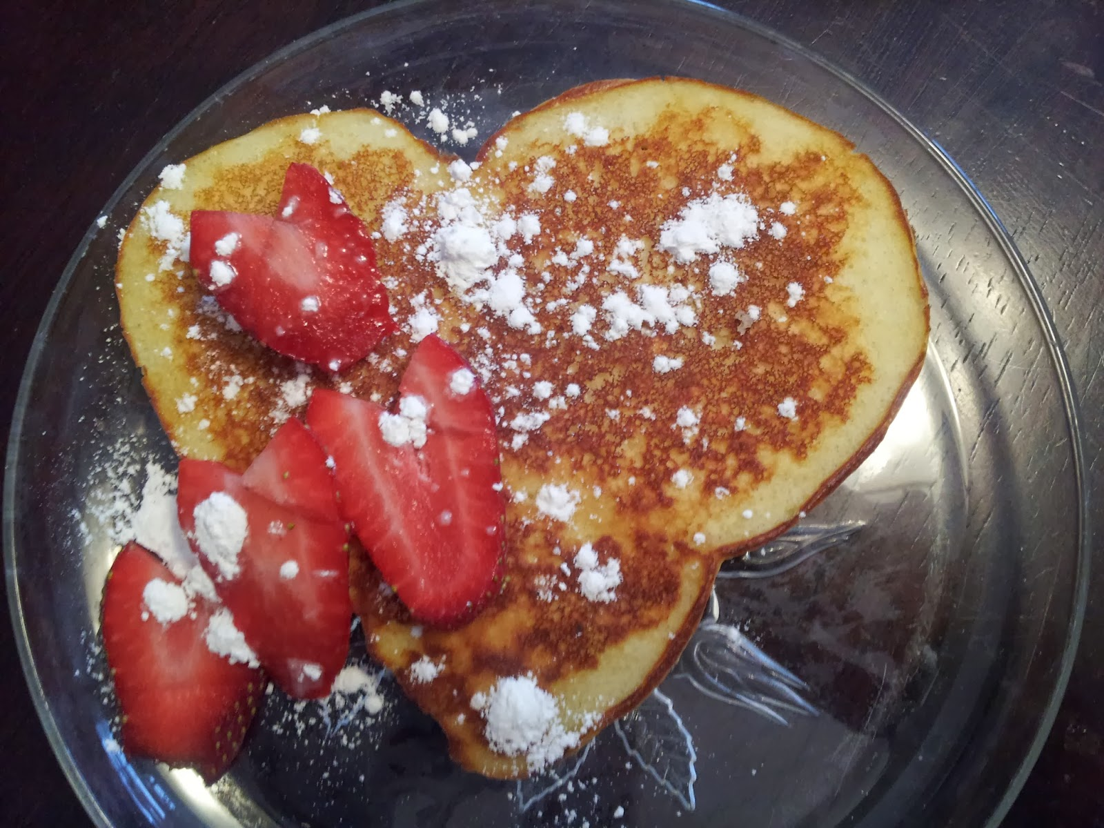 Valentine's Day heart-shaped pancakes and strawberries, breakfast