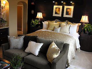 sofa pies de la cama