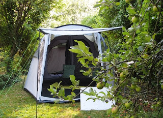 Our huge tent nestling among apple trees and large bushes
