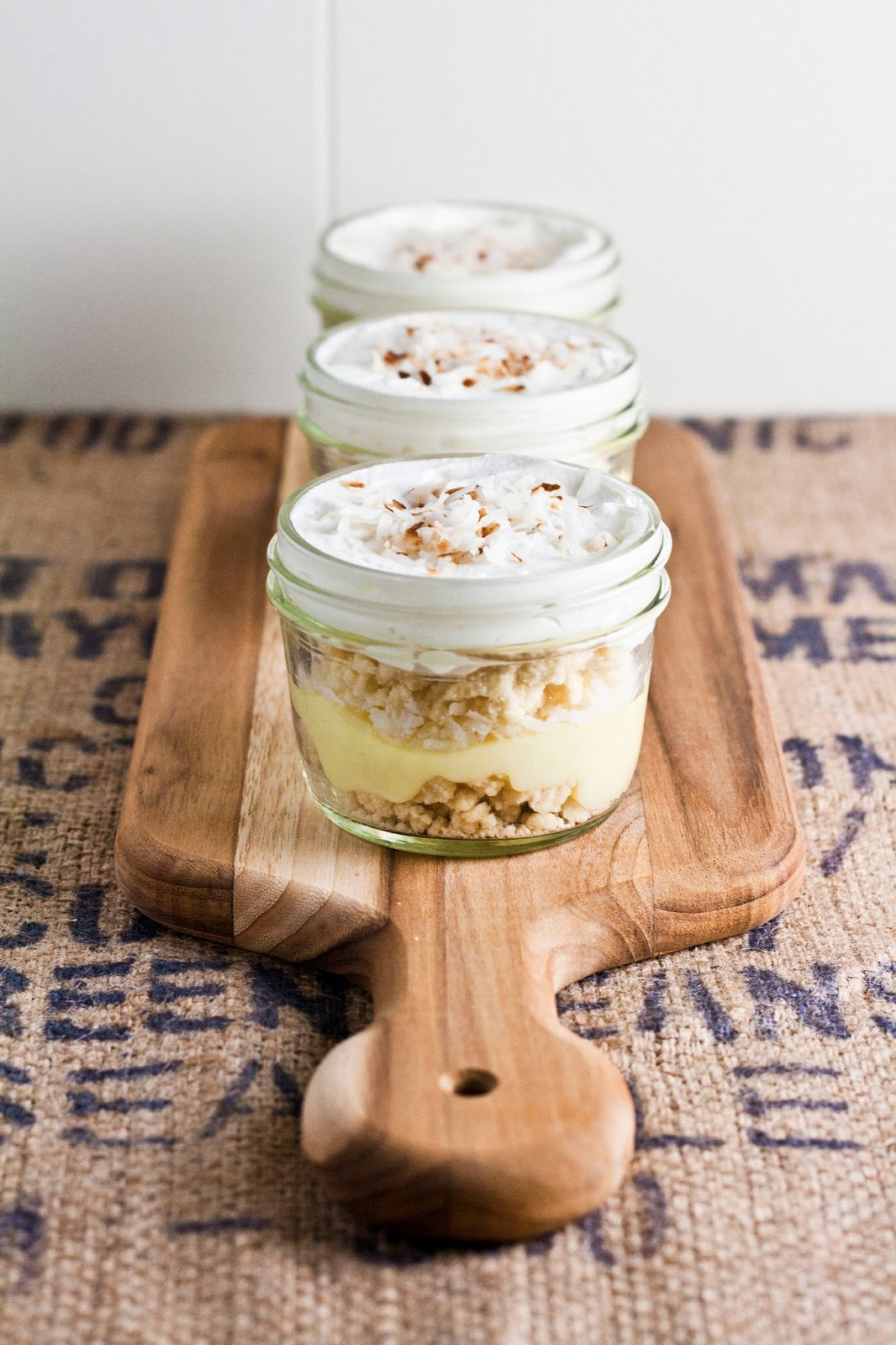 ... garnish of coconut flakes voila lemon and coconut cream pie in a jar