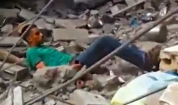 Palestinian civilian searching through rubble for family members is murdered by Israeli troops.
