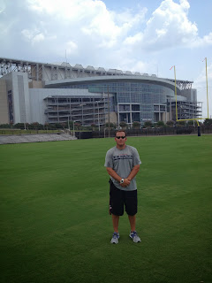 Martinez stands outside Reliant Stadium.