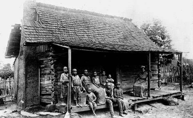 Slave family on porch of cabin barbour county alabama late 19th c