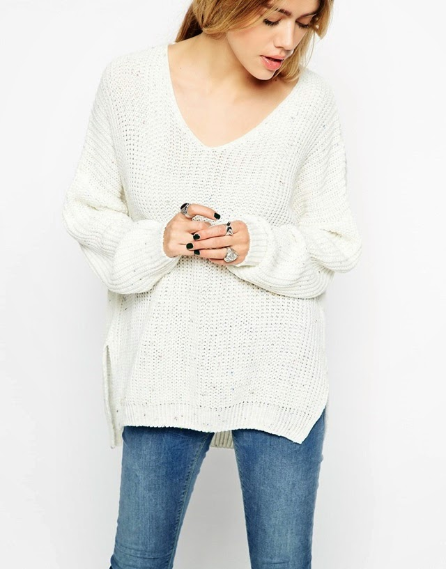 white v neck chunky knit sweater black nails and silver rings