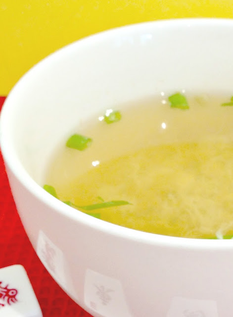 bowl of vegetarian egg drop soup and scallions chopped up