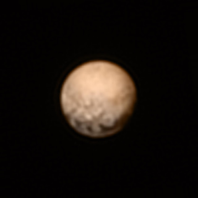 This color version of a New Horizons Long Range Reconaissance Imager (LORRI) picture of Pluto taken July 3, 2015, was created by adding color data from the Ralph instrument gathered earlier in the mission. The LORRI image was taken from a range of 7.8 million miles (12.5 million km), with a central longitude of 19°.   Credit: NASA/Johns Hopkins University Applied Physics Laboratory/Southwest Research Institute