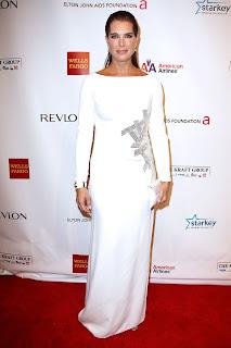 Brooke Shields wearing a white dress