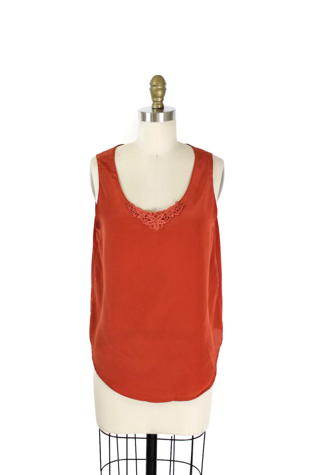 1980s burnt orange sleeveless blouse