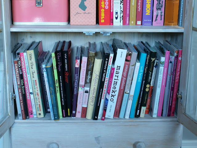 vintage books shelf pinup fashion history