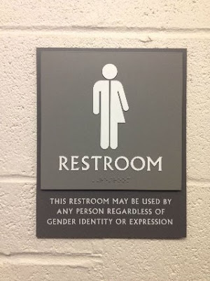 Public toilette sign at  Reed College (Gray Campus Center) in Portland - OR (U.S.A.)