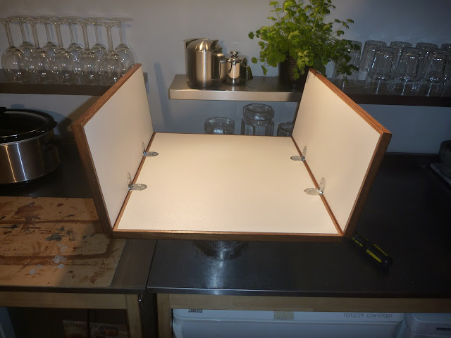 Half opened tabeltop for Lagun table. Teak fiddle rails, WISA Multiwall surfaces, and chrome counterflap hinges.