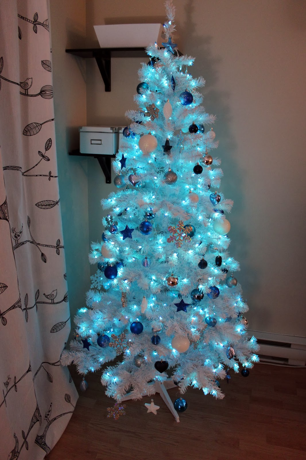 i did cute silver blue and snow flakes printed boxes in the bookcase and silver candle holders with a mini christmas tree - White Christmas Tree With Blue And Silver Decorations