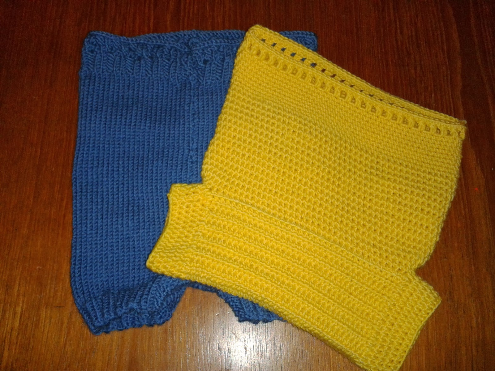 Two woollen nappy covers one blue one yellow