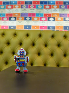A toy robot in a pub