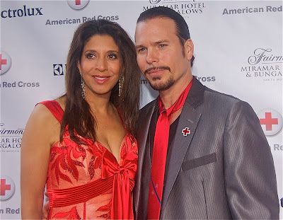 Christine Devine of Fox 11 News and Quiet Riot's Sean McNabb of Sons of Anarchy.  Devine emceed the event for the Red Cross