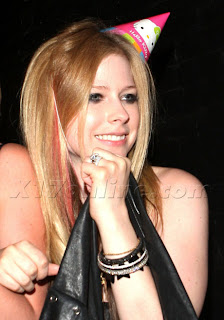 Avril Lavigne and Hello Kitty party hat