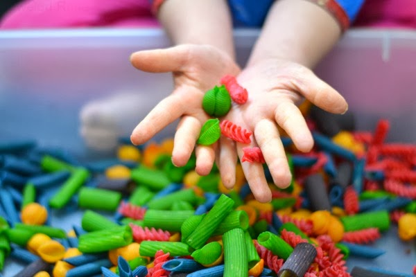 How to make kool-aid dyed pasta for crafting, making scented pasta necklaces, sensory play, counting, sorting, early math concepts, and MORE!