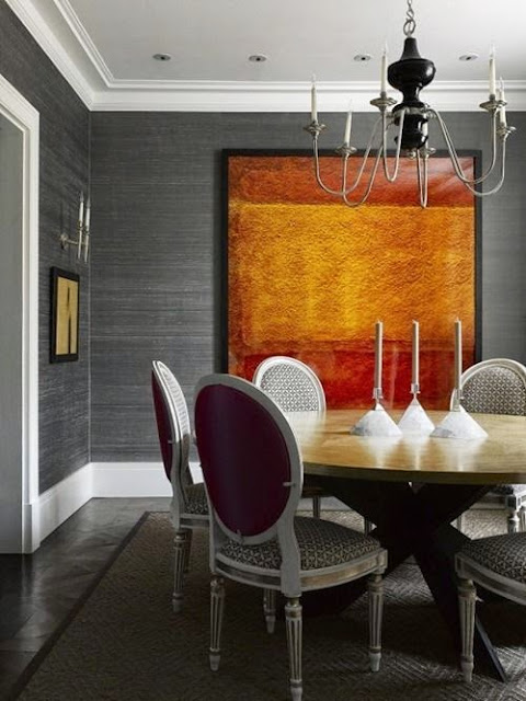 beautiful gray dining room with gold and modern art vignette