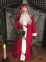 Standing Santa In Red Suit With Sled