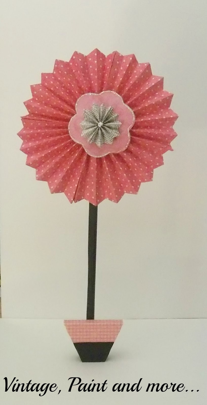 Vintage, Paint and more... pinwheel flower made from scrapbook paper, glitter and wood scraps