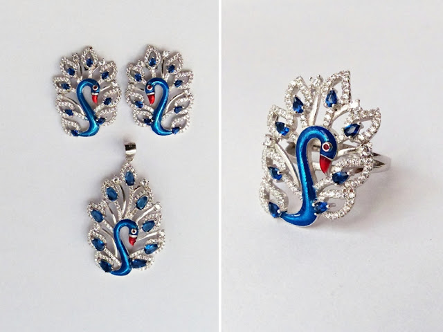 Silver peacock jewelry set: earrings, pendant and ring