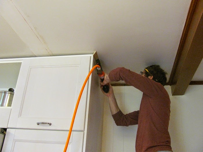 Putting Crown Moulding At Different Heights For Corner Kitchen Cabinets