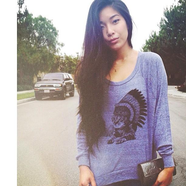 Stephanie Liu of Honey & Silk wearing Skip n Whistle's Cat Chief sweater