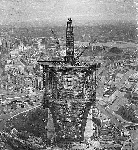 View from pulley-wheels of north side creeper-crane (jibbed right out) looking into box section of south side arch, Sydney Harbour Bridge, May 1930 / Ted Hood (hanging upside down 130 metres - 420 feet - above the Harbour)
