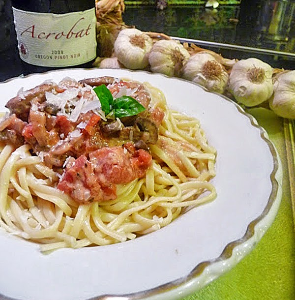 Sweet Italian Chicken Sausage with Tomato Cream Sauce Over Linguine
