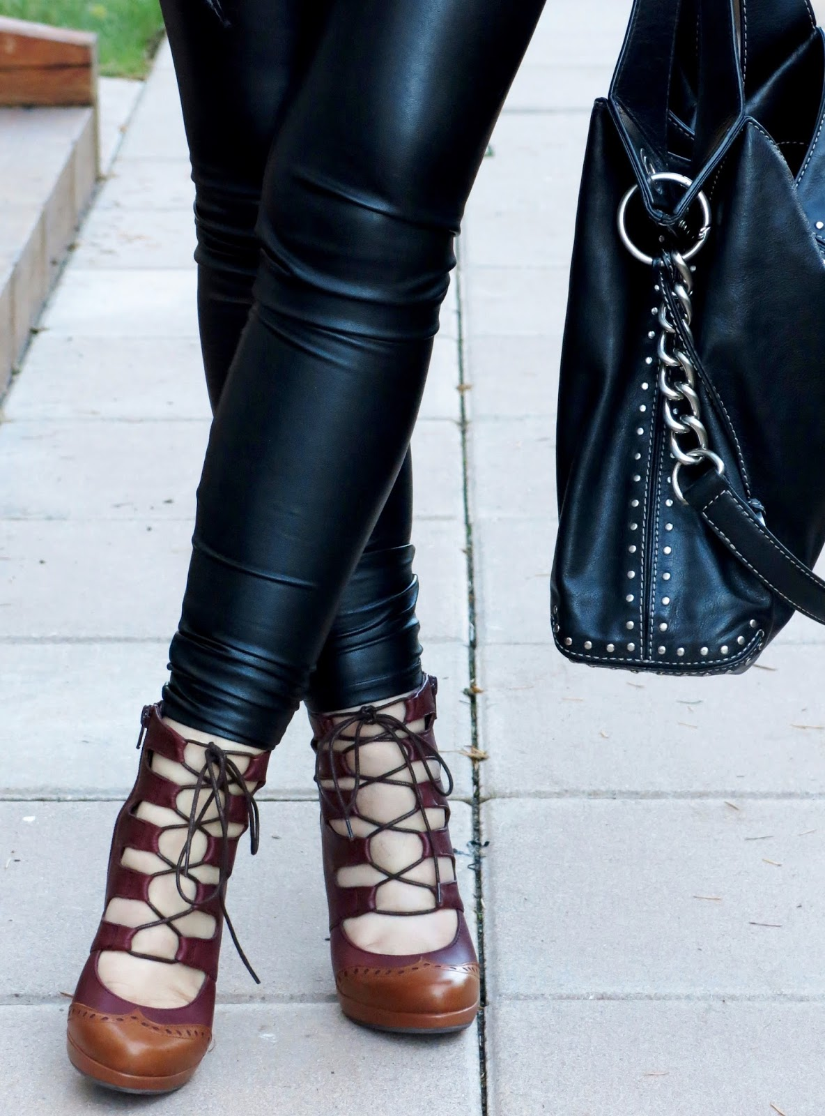 vegan leather leggings, lace-up heels, and Michael Kors bag