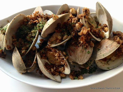 grilled clams with breadcrumbs and pine nuts