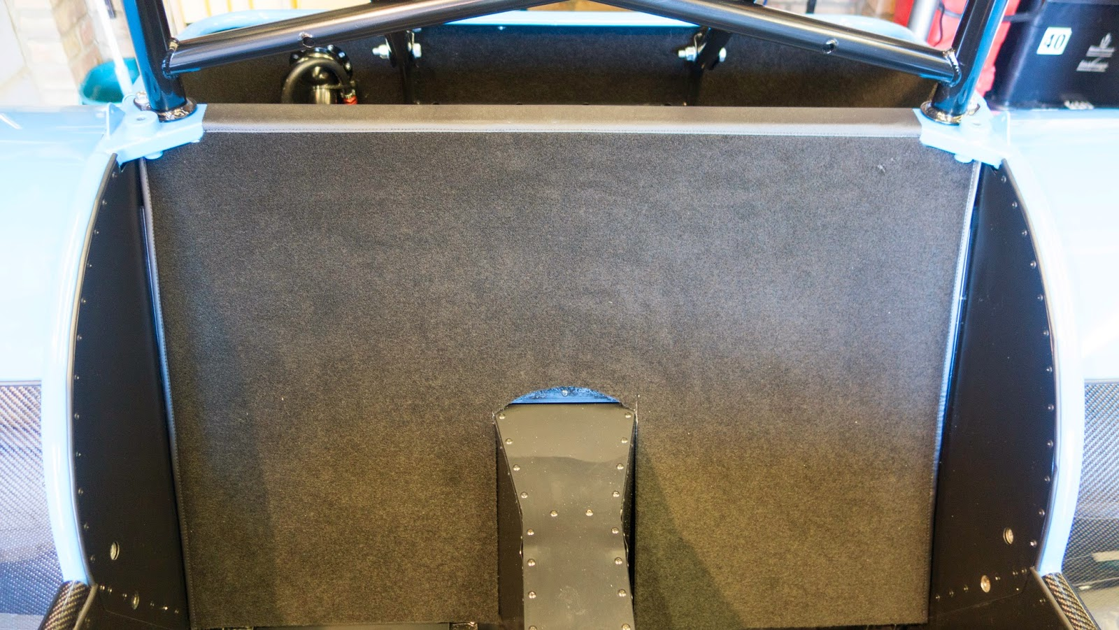 Rear bulkhead carpeted.