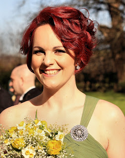 Bridesmaid with short red hair and green dress