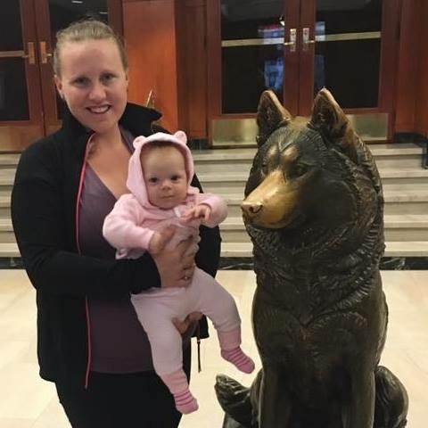 Baby Maya meets King the Husky