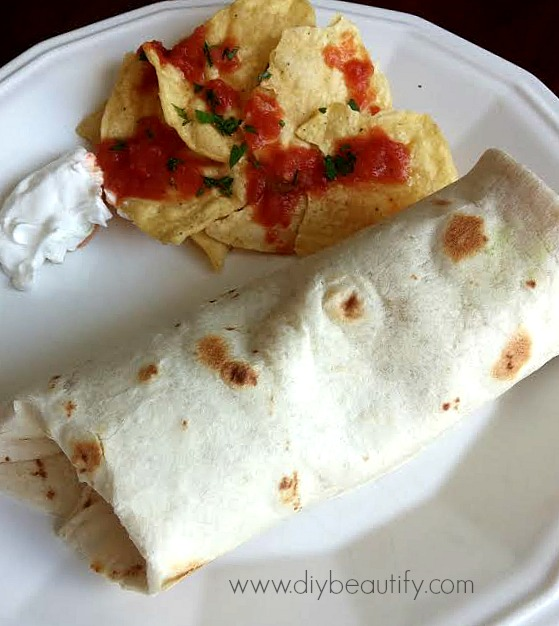 Shredded chicken burritos are a simple and delicious dinner! Recipe available at www.diybeautify.com