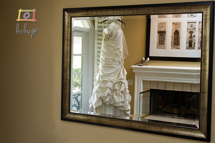 The Bridal Suite at Westlake Village Inn has a wonderful fire place and when I saw the reflection from the mirror across the room, I had to put the wedding gown and the shoes there.