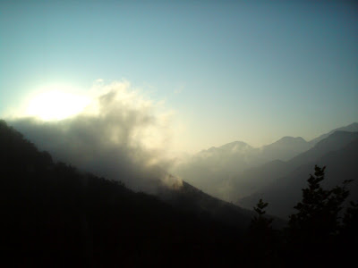 Sun, mountains,cloud cover and sunrise in the Garhwal Himalayas