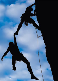 Blue and black image of mountain climbers demonstrating high trust.