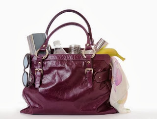 glamorous handbag with Mum things in