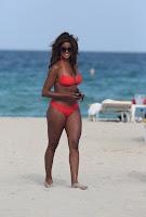 Claudia Jordan walking on the beach