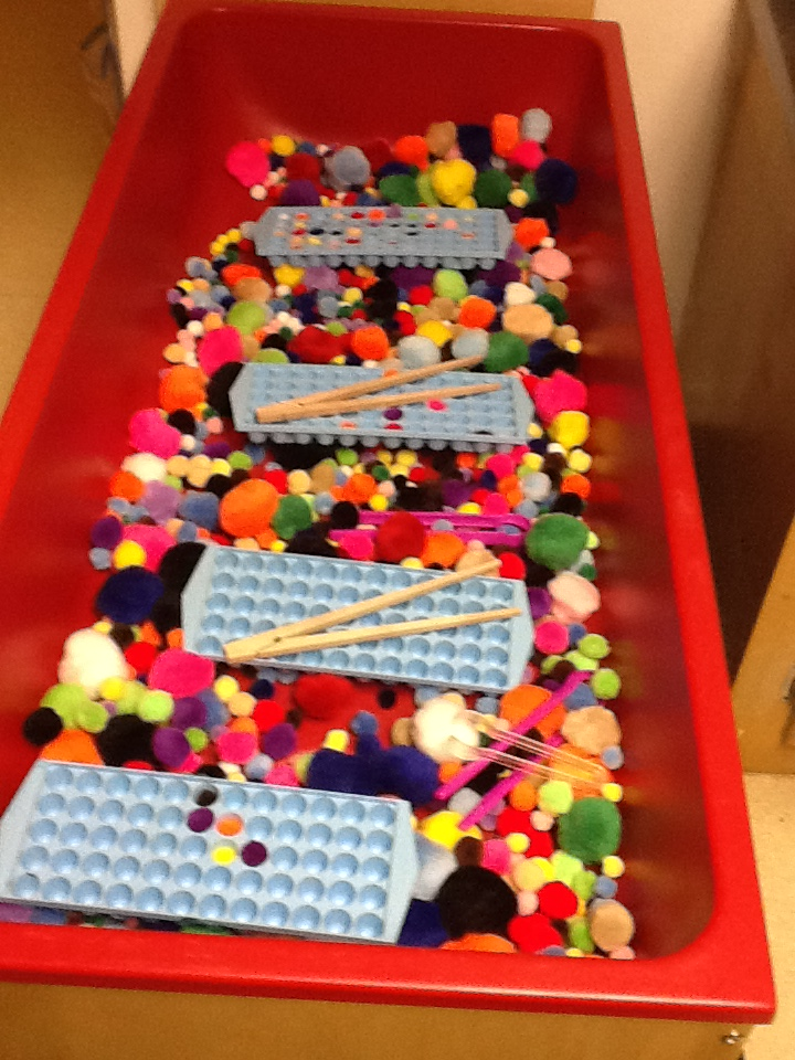 sensory table idea pom poms