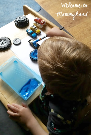 Invitation to paint with wheels by Welcome to Mommyhood #transportation, #montessori, #artsandcrafts, #preschoolactivities