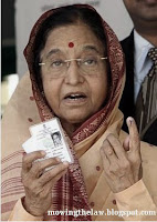 Indian President politician Prathiba Patil after voting election showing dot on finger with election card
